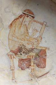 Fresco of a muse tuning two lyres c.460 BC from the Louvre Museum, Paris (image: Jastrow)